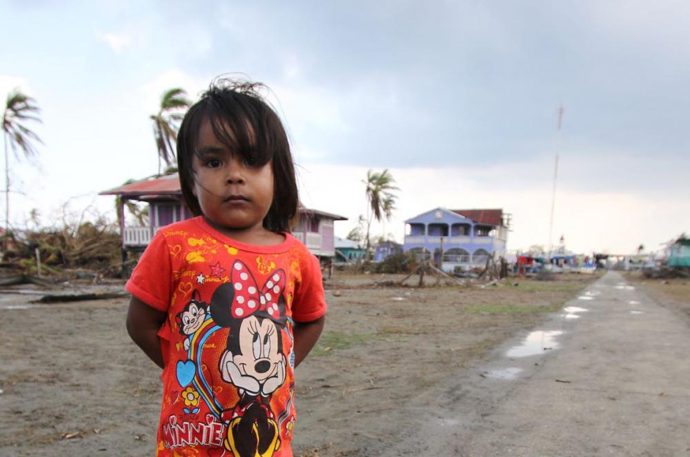 Photo from Hurricane Eta. A girl in front of destroyed homes
